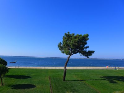 Photo for Large duplex 1st line large terrace to the west, overlooking Cap-Ferret