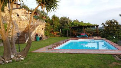 Photo for hillside house with large garden and swimming pool overlooking the sea.