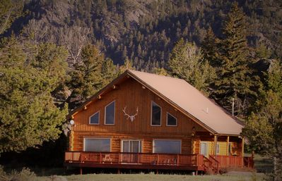 Photo for Spacious Log Home 15 min north of Yellowstone Park. Sleeps 12, wrap around deck!