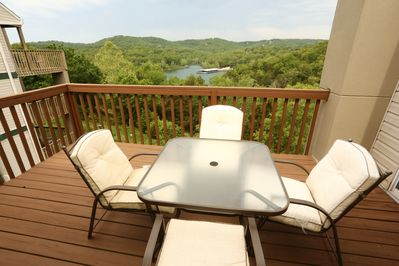 Private balcony overlooks the hills and lake.