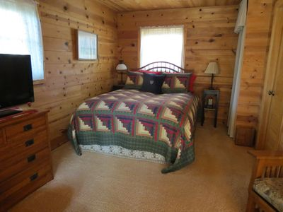 Comfy queen size bed with feather bed and down comforter