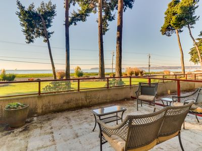 Photo for NEW LISTING! Updated condo right on the water with tremendous views!
