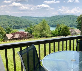 Covered L-shapped patio overlooking lake and mountains