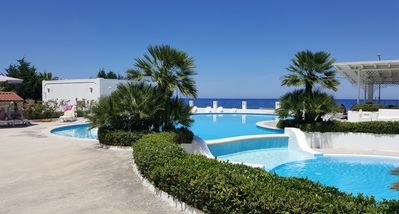 Photo for Beautiful one-bedroom villa, right on the sea, swimming in the pool, culture and relax ...