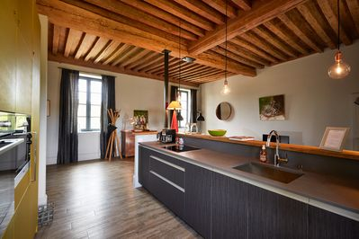 Large living room, old wood beams ceiling, very bright, fitted kitchen