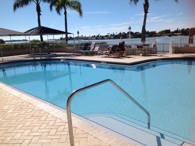 Pool is steps from condo shallow end is a walk in.
