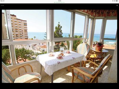 Photo for Bright apartment on the beach with panoramic views, wifi and garage.