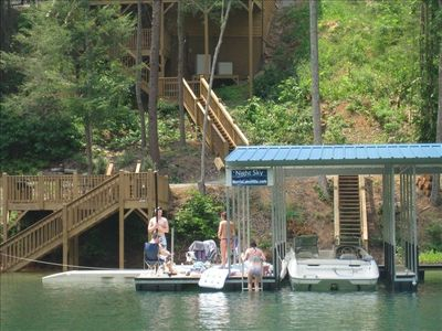 Private two slip covered dock, 2 ski lifts, swim platform, lights & outlets
