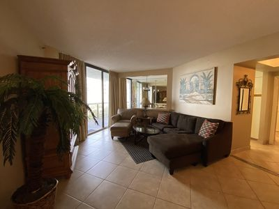 Relax in our spacious living room with a flat screen TV and comfy couch!