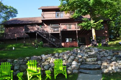 Lake side of house showing balconies and hot tub.