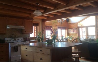 Large kitchen island to great room. natural gathering places.
