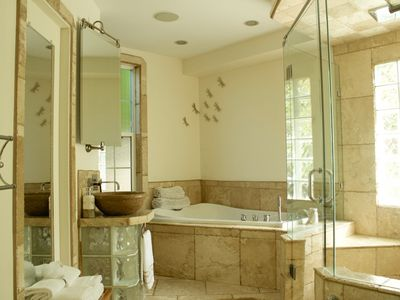 Beautifully landscaped with privacy in mind, soaker tub and 4x5 walk in shower