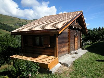 Photo for Chalet of charm renovated in an old attic, close to the tracks, located in