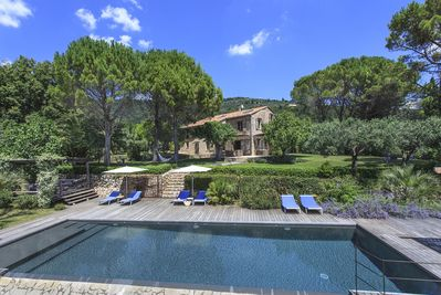 Relax by the pool, surrounded by a 2-acre mature garden.