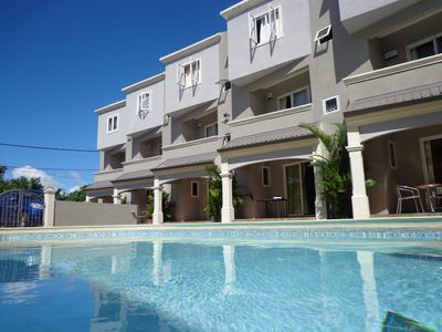 Photo for Well Situated,nearby Shopping, Beach 2 Mins Walk,swimming Pool,secured Parking,