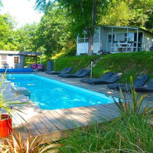 Photo for Riverfront cottage with shared heated pool near Biarritz