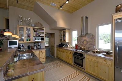 Gourmet Kitchen with Miele & Viking Appliances and Knotty Pine Cabinets