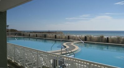 Photo for EASY ACCESS! Step off your Patio & into the Pool / Steps to Beach / Ocean View!