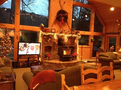 """family room- wood stove & 4 couches, 60"""" smart tv, Dish Network, Bose surround."""