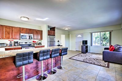 A bright and airy living space invites you into your Waikiki vacation rental.