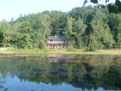 Secluded stone house with a 50 ' deck overlooking Beaver Lake on mushroom farm.