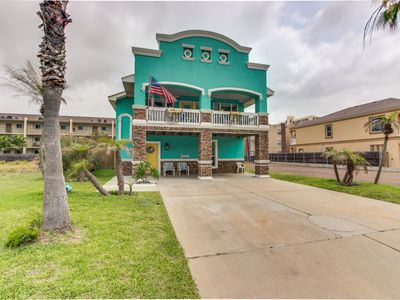 Spacious vacation home with a private pool & balcony - steps from the beach!