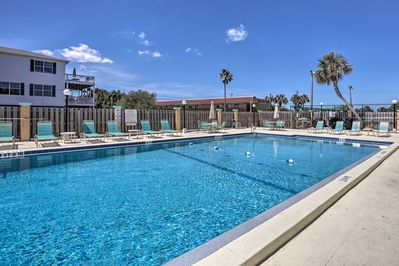 Relax by the community pool or head to the beach.