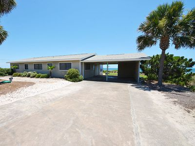 Photo for This is a COZY GROUND LEVEL three bedroom, two bath, beach front house.