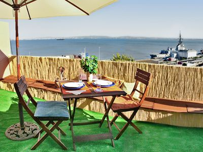 Photo for Amazing view of the river Tagus & panoramic Terrace. City Centre. Free Wifi