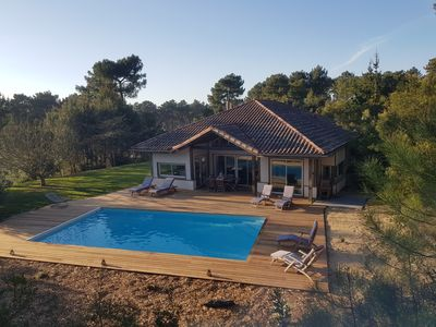Photo for Magnificent villa 166 m2, 10/12 p, private heated pool 5x10m, wifi near the golf courses and the beach.