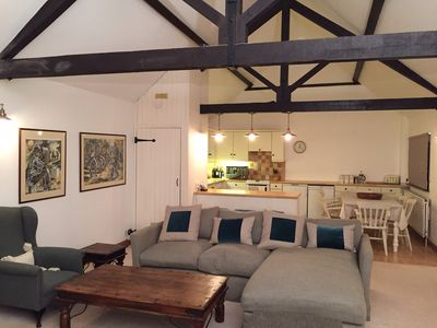 Spacious living room & kitchen in barn conversion.