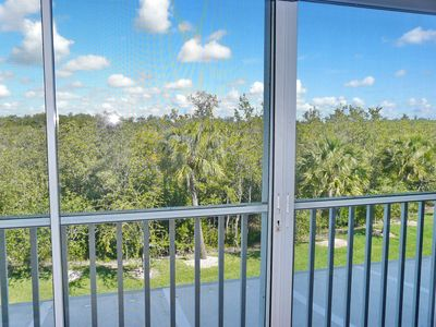 Photo for Secluded condo in quiet section of Island w/ heated pool & hot tub