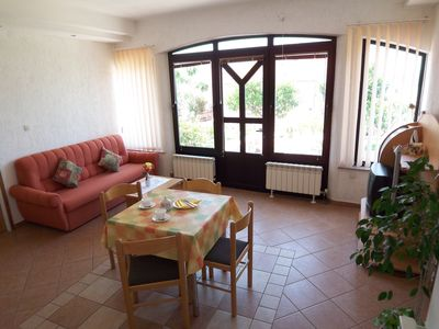 Photo for Vacation apartment in an attractive vacation villa only 300 meters from the sea
