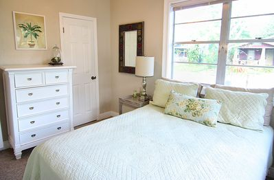 Guest bedroom 2 with a queen bed.