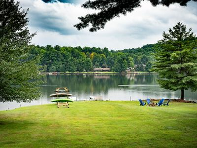 Photo for Largest flat waterfront yard on Treasure Lake! Waterfront beauty year round!