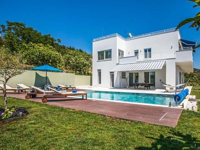 Photo for 4 bedroom Villa, sleeps 10 with Air Con, FREE WiFi and Walk to Beach & Shops