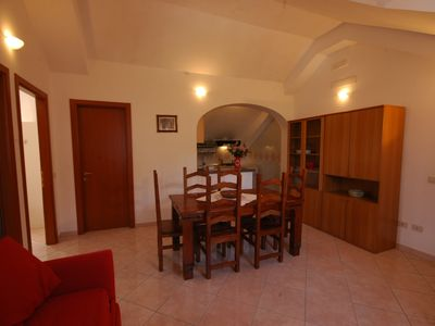 Photo for Il Libeccio A3 2 bedroom apartment with access to the garden and swimming pool