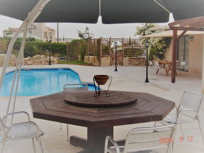 Huge terrace with pool and dining, on one level...