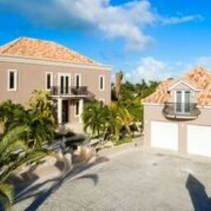 Photo for 4 Bed Luxury Villa Rental on the Award Winning Grace Bay Beach in Turks & Caicos