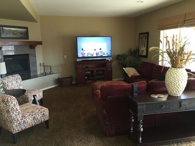 "60"" TV and Fireplace in walk-out basement"