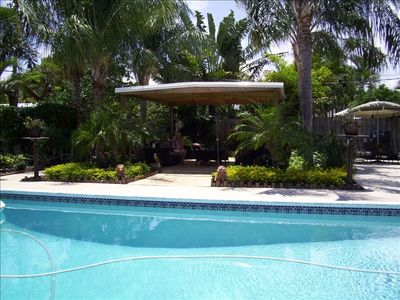 BACKYARD view of CASA del SOL's lush secluded tropical oasis and swimming pool