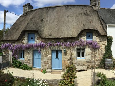 Photo for Adorable Breton Cottage with thatched roof and stone walls.