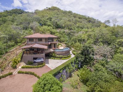 Casa Acuario is surrounded by vibrant, green trees in a tropical setting that overlooks spectacular ocean views.