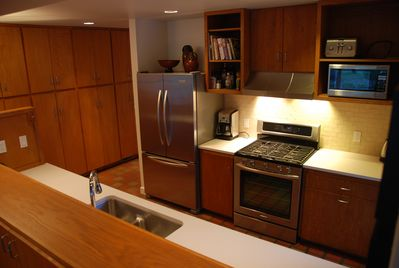 Freshly renovated kitchen with all new appliances, including a gas stove