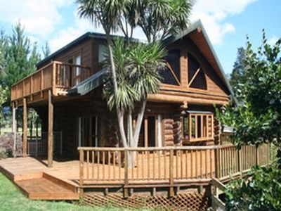 Photo for Tranquil Log Cabin alongside a river,  in a beautiful natural location,