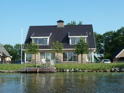 Photo for Rural 2-under-1 roof house with river view