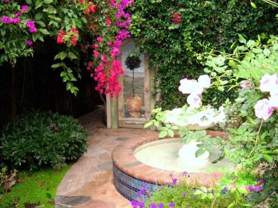 beautiful backyard area fountain with pond,lush private quiet an oasis!