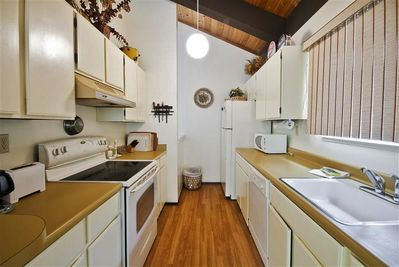 This charming kitchen comes fully equipped with all the necessary modern cooking appliances