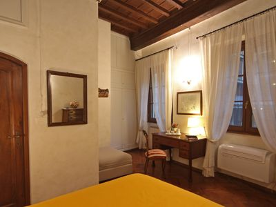 Photo for Charming apartment near Ponte Vecchio Free Wi-fi, Aircond,  bikes and Garage!