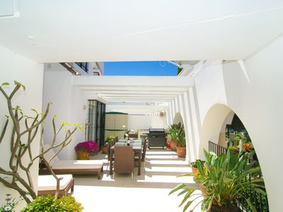 Photo for White Pearl Beach apartment with shared garden, heated pool